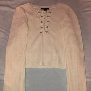 Medium cream knit sweater with lace up front